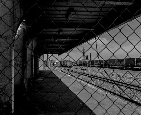black and white train station